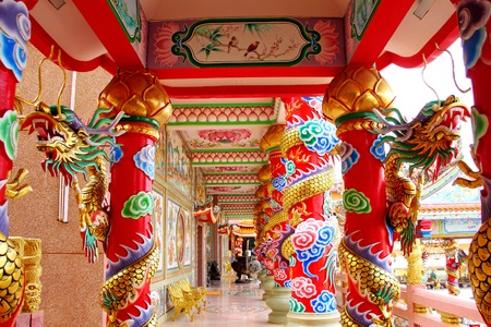 Numerous dragons coiled round pillars within the main building of Naja Shrine, Chinese temple at Angsila, Chonburi, Thailand. photo