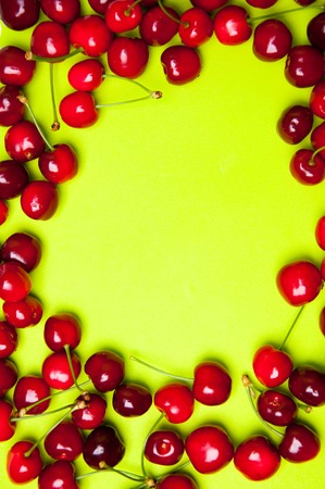 gean: Red sweet cherries on green background