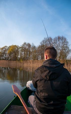 angler: Angler fishing with rod on boat Stock Photo