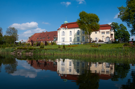 restored: Restored palace by the lake in Trzyglow, Poland