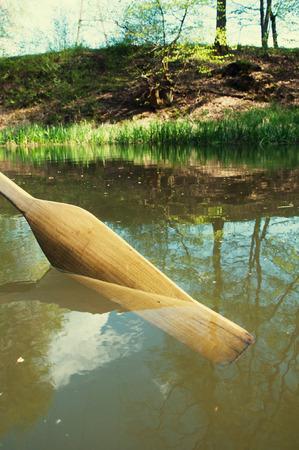sculling: Rowing oar on river