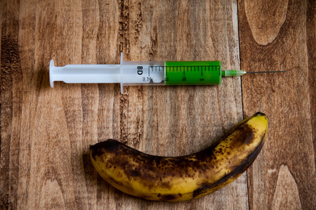 injected: Overripe banana being injected with a syringe
