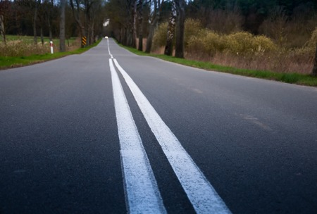 roadway: A roadway stretches off into the distance Stock Photo
