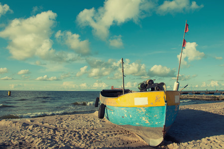 moored: Old fishing boat moored on the beach