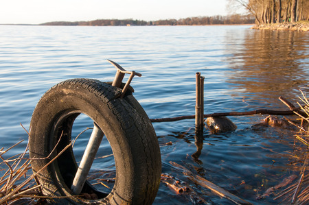 putrefy: Garbage and old tire in the water