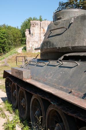 postwar: Old postwar tank on grass Stock Photo