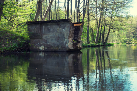 disruption: Old ruined postwar bridge over the river