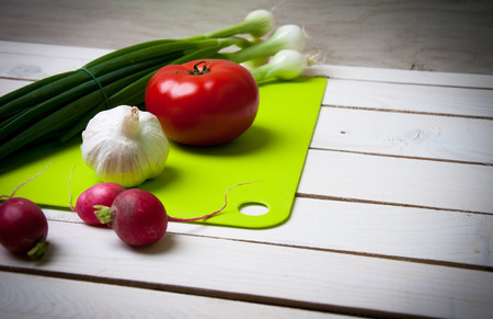 bulb and stem vegetables: Vegetables on wooden table Stock Photo