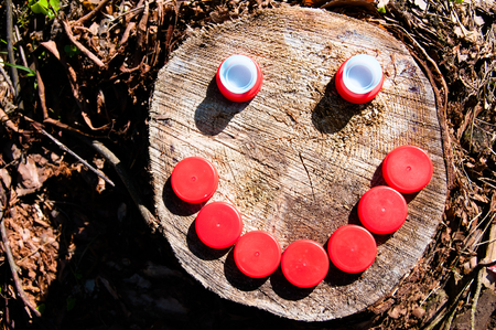 Smile made of plastic caps