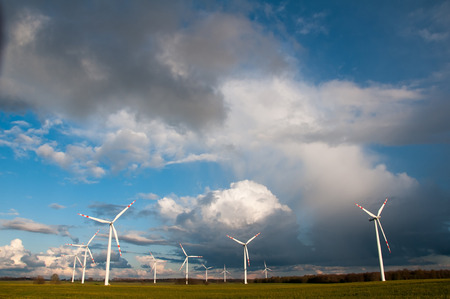 wind force wheel: Wind turbines on the field before storm Stock Photo