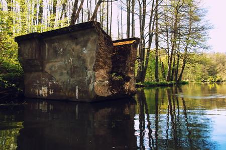 postwar: Old ruined postwar bridge over the river