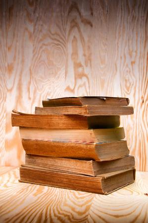 antiquarian: Vintage antiquarian books pile on wooden surface