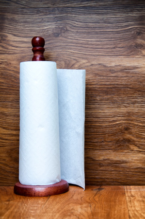 Kitchen paper towel on wooden holder Stock Photo