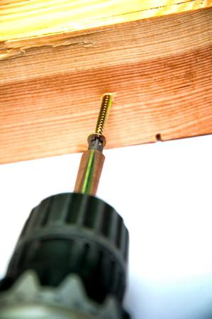 screwing: Wireless screwdriver screwing the screw