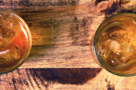 scotch: Glass of scotch whiskey on a wooden table