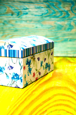 Floral patterned casket for jewelry on colorful background Stock Photo