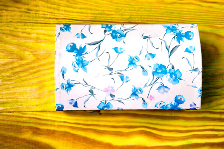 casket: Floral patterned casket for jewelry on colorful background Stock Photo