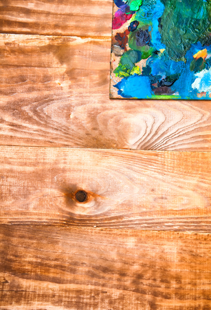 Painting palette on wooden background