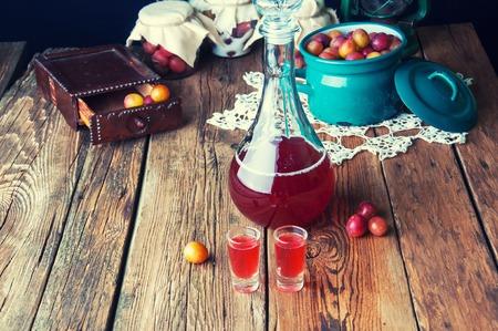 Healthy plum tincture in old kitchen
