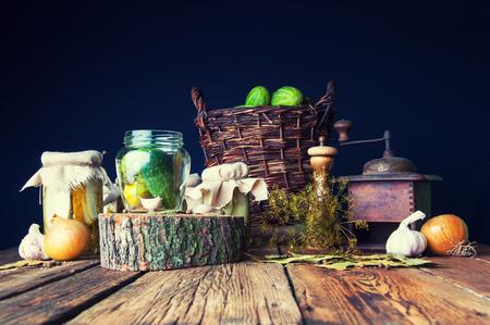 marinated gherkins: Preparation of pickles in jars Stock Photo