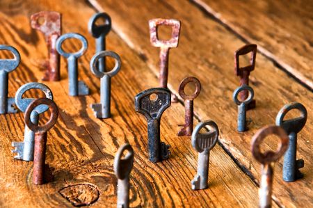 Old rusty keys on wooden background Stock Photo