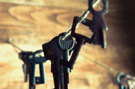 twine: Old rusty keys hanging on a twine