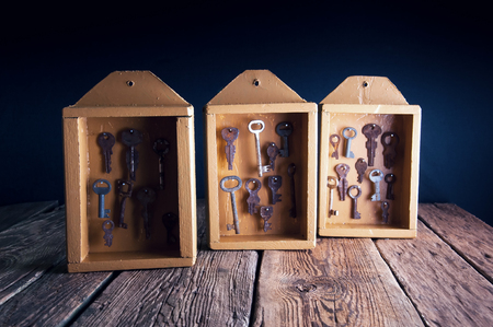 key cabinet: Boxes with old keys for hotel rooms Stock Photo