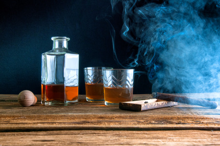 snifter: Whisky and cigar on wooden table