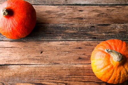 Pumpkins on vintage wooden table. Copyspace. View from above