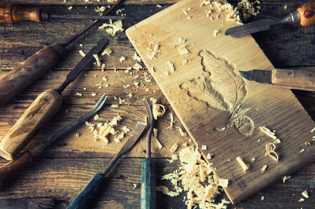 chisels: Chisels and carved piece of wood in traditional carpenter workshop