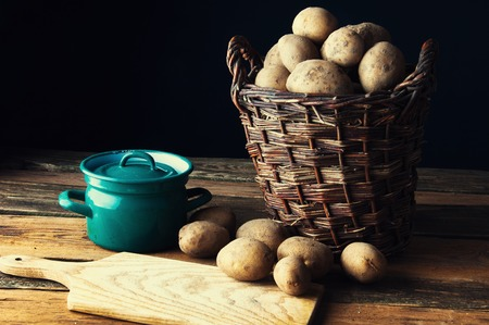 rustic kitchen: Potatoes in old rustic kitchen Stock Photo