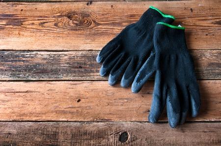 gardening gloves: Gardening gloves on wooden background. Copyspace Stock Photo