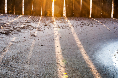 breakwater: Sun shining through the breakwater