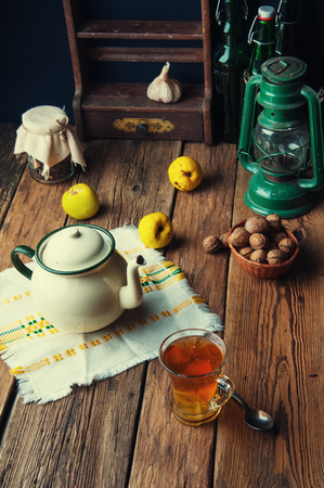 rustic kitchen: Hot tea for autumn. Old rustic kitchen Stock Photo