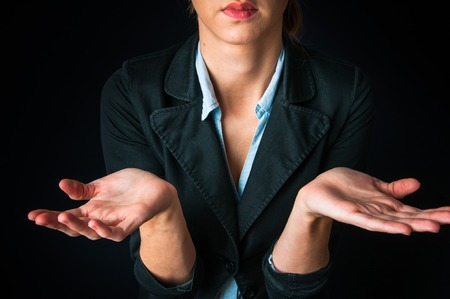 i don't know: Businesswoman showing I dont know gesture Stock Photo