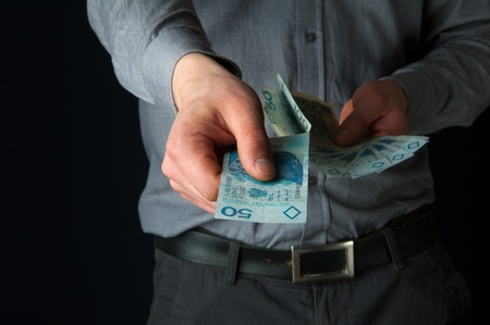 paying: Business person paying cash