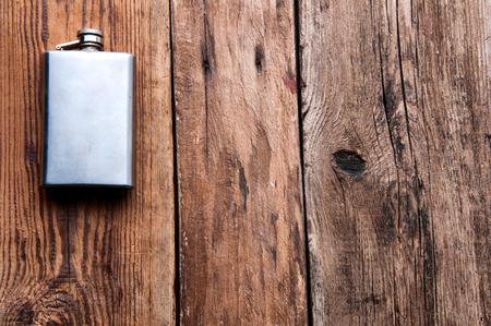 Metal silver hip-flask, copyspace