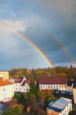 Rainbow over the city in autumn Standard-Bild