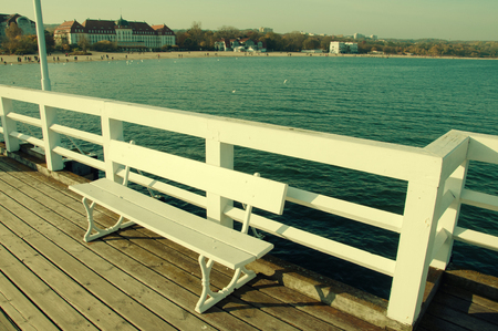 White bench on the pier