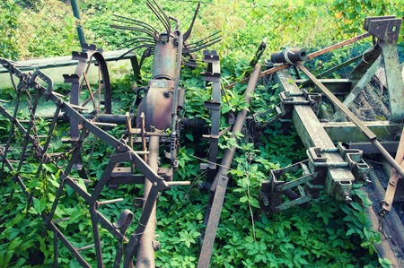 Old rusty cultivator on country