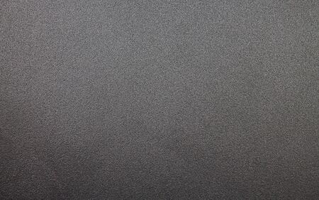 A metal plate texture in an antharcite color.