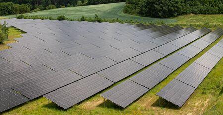 Photovoltaic Solar Farm with black panels as complete facility Foto de archivo