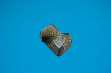 Staurolite often occurs twinned in a characteristic cross-shape, called cruciform penetration twinning. In handsamples, macroscopically visible staurolite crystals are of prismatic shape. The mineral often forms porphyroblasts.