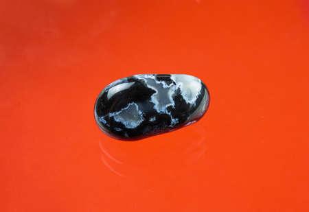 Black agate with transparent white quartz inclusions
