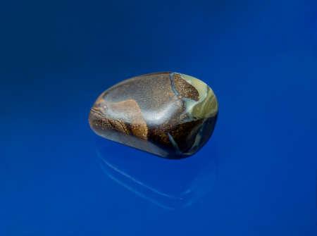Australian boulder opal sanded to enhance the gloss of the opal