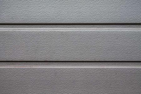 Texture of an aluminum garage door. Stock Photo