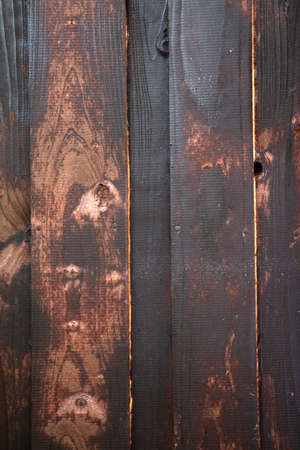Texture of an old brown wooden wall. The slats are installed horizontally. Foto de archivo