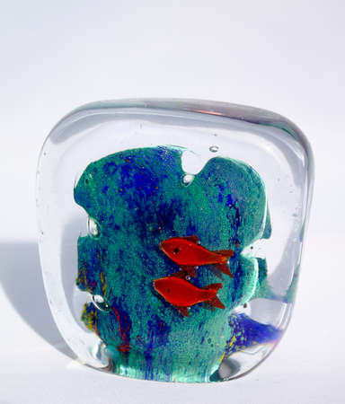 Murano paperweight as an aquarium. Inside with a reef and two red fish.