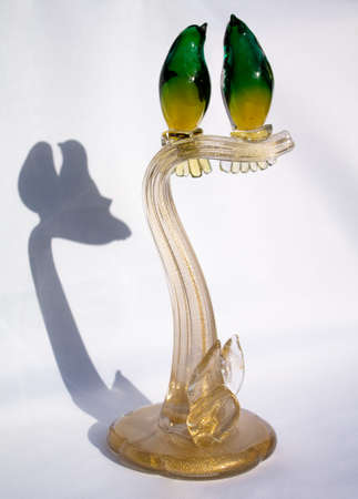 Murano mouth blown tree branch with two green yellow birds. Inside there is real gold. Stok Fotoğraf