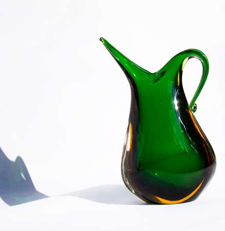 Murano handle vase in green uranium glass. Mouth blown.